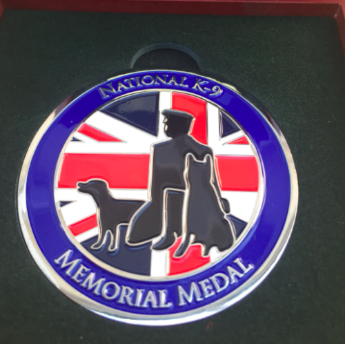 This image has an empty alt attribute; its file name is memorial-medal-1.png